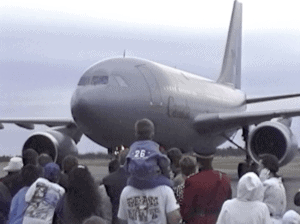 Crowd at Yellowknife airport greet the Queen's arrival from opening the Commonwealth Games in Victoria on August 19, 1994, as video documented by Henry Tenby.