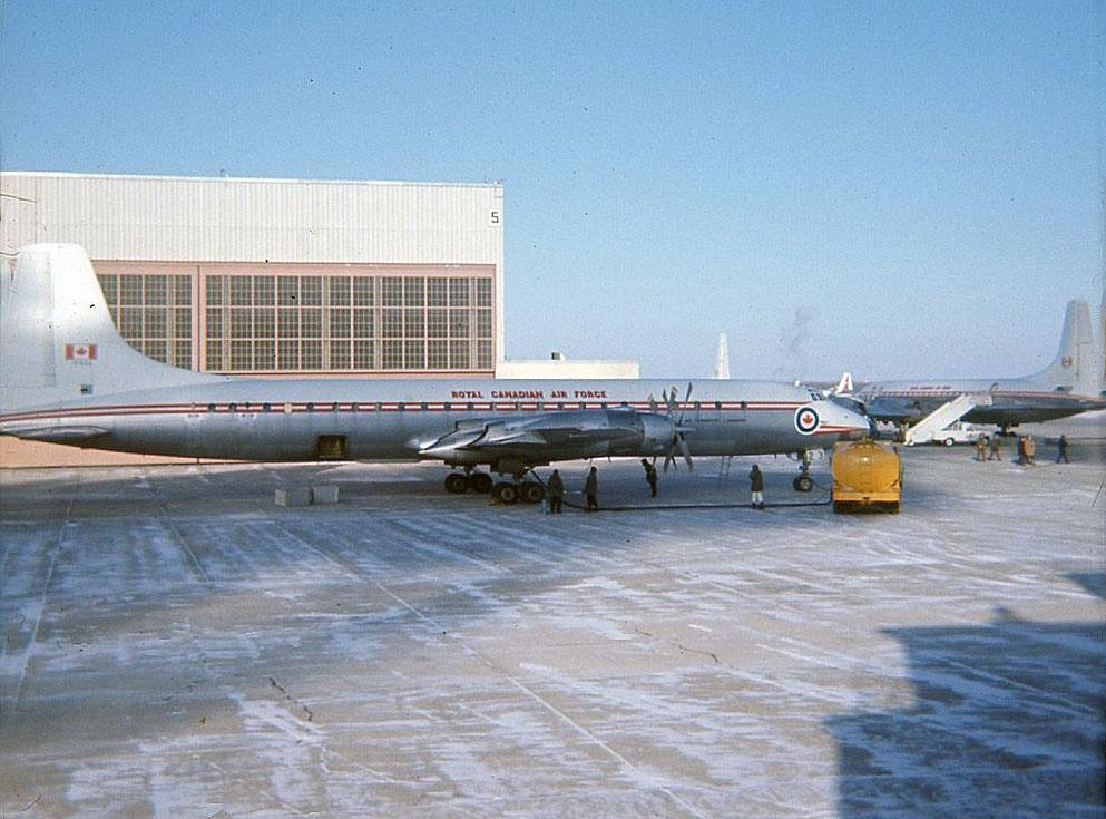 RCAF Royal Canadian Air Force Canadair CL-44 Yukon 15923 at CFB Namao with another Yukon winter 1967.